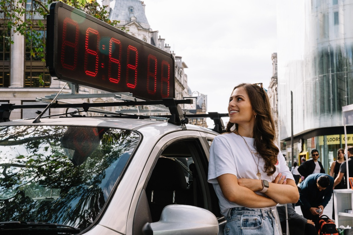 Steph Elswood joins the revolution against pollution this World Car Free Day - Steph outside car.jpg